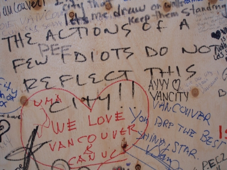 Messages of sorrow and hope on the boards of looted stores.